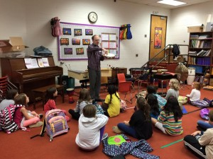Timpanist Peter Zlotnick demonstrates percussion instruments for young children