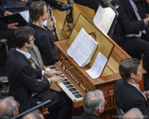 Organist Nicolas Haigh performs as a member of the continuo.